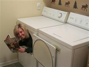 Mrs. Truchan sitting inside a dryer reading.