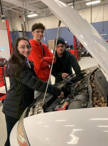 Auto tech students working on a car