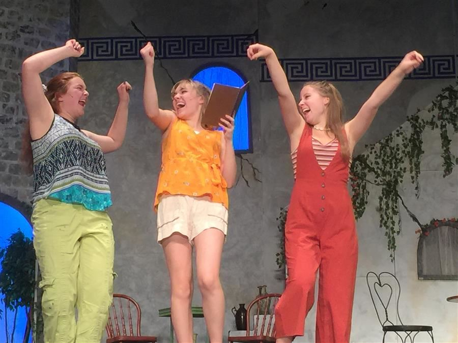 students acting in Mamma Mia show